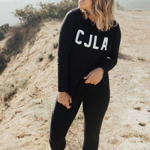 CARLY JEAN LOS ANGELES black sweater white CJLA